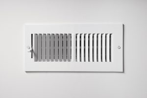 cooling-vent-on-wall-of-home