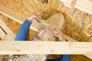 worker-insulating-duct-in-attic