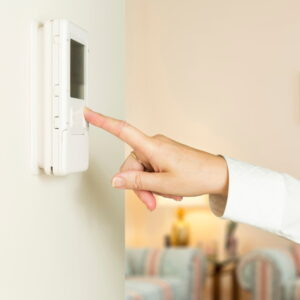 person-adjusting-thermostat